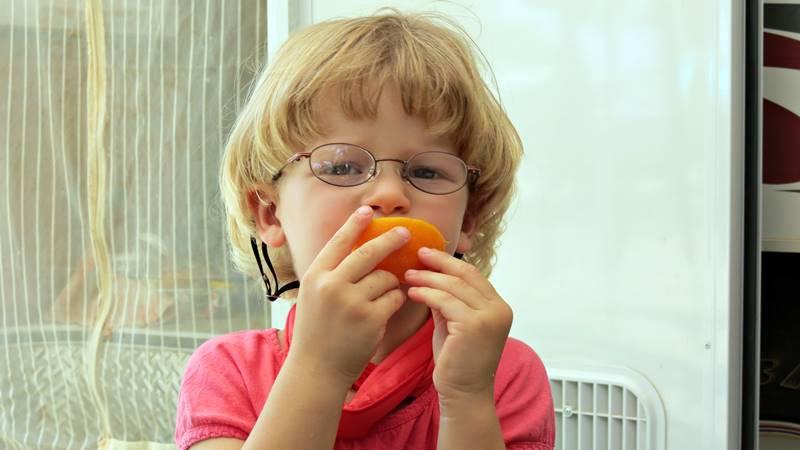 Nell eating frozen orange