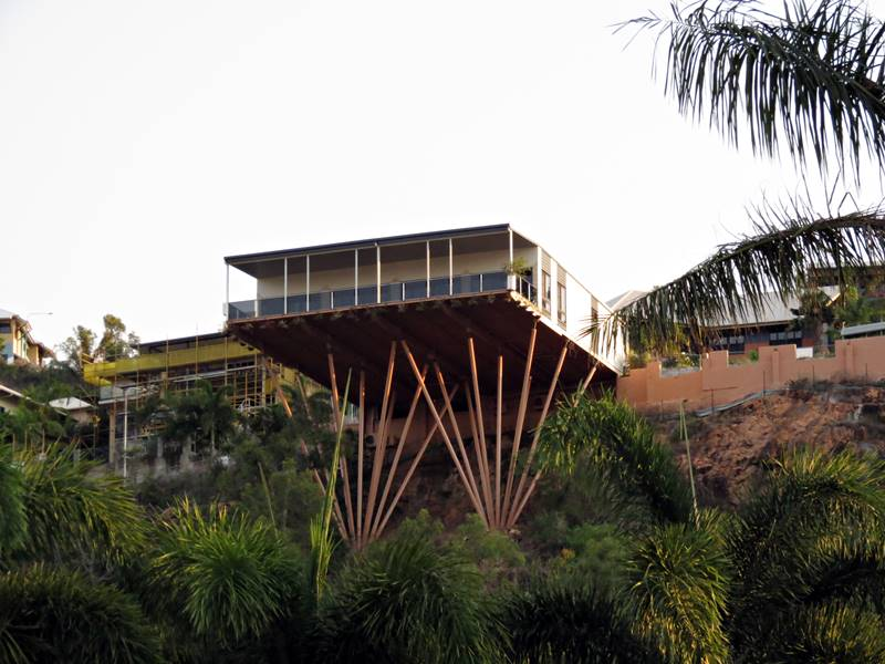 House hanging of the cliff built on vertical poles
