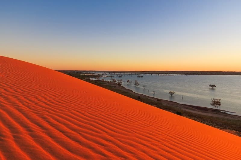 Sunrise at Big Red over a dune